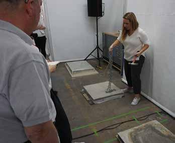 Ann Harrer, WJE, demonstrates NDT methods on concrete samples