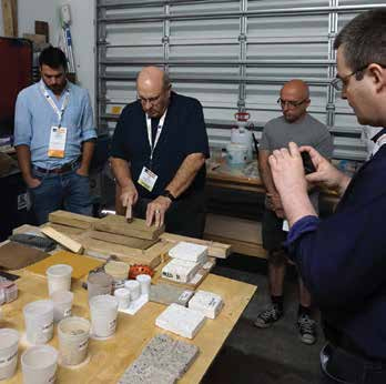 Bob Joyce, Quality Restorations, Inc., demonstrates matching and surface treatments